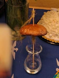 mushroom drop spindle with cornsilk fiber